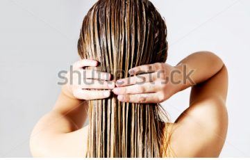 stock-photo-woman-applying-hair-conditioner-isolated-on-white-446850223